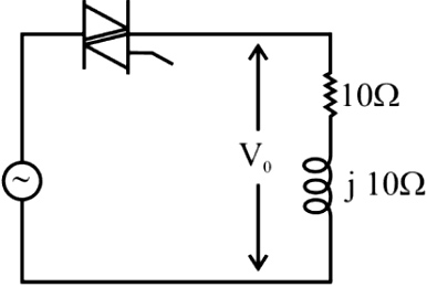 A triac based single-phase voltage regulator feeds an R-L load as shown in the figure.